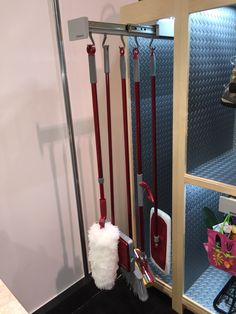 Glideware in a utility closet.  Keep all your brooms and mops off the floor while keeping them totally accessible! Made in Polypropylene plastic so its easy to clean! www.glideware.com