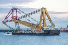 The Asian Hercules III, one of the world's biggest floating cranes, arrived in Peterhead Port today to begin work on Vattenfall's European Offshore Wind Deployment Centre. Crane Construction, Construction News, Offshore Wind, Engin, Aberdeen, Heavy Equipment, Hercules, Sailing Ships, Scotland