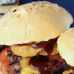 The Ultimate Cowboy Burgers Recipe Main Dishes with bacon, ground beef, minced garlic, worcestershire sauce, kosher salt, cracked black pepper, burgers, shredded cheddar cheese, rolls, mayonnaise, lettuce, tomatoes, onion rings, bbq sauce, zucchini, yellow squash, kosher salt, bacon drippings, seasoning