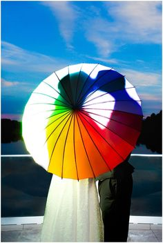 This (MoMA rainbow umbrella) silhouette portrait of the bride and groom is so whimsical. Iowa Wedding Photography | CTW Photography