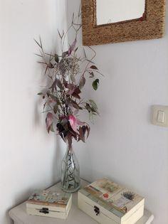 botella de cava con flores secas