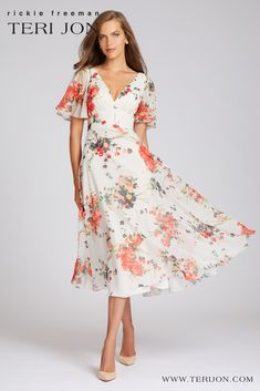This white multi tea length dress is a great for all body types. With floral short sleeves, a v-neckline, and floral detail, you won't stop getting compliments while wearing this dress. Perfect for cocktail parties, rehearsal dinners, and graduation parties. Gowns With Sleeves, Short Sleeves, Backyard Weddings, Printed Gowns, Graduation Parties, Pearl Dress, Cocktail Parties, Sequin Gown, A Line Gown