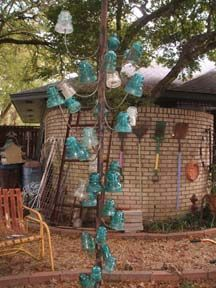 New kind of bottle tree using glass insulators.