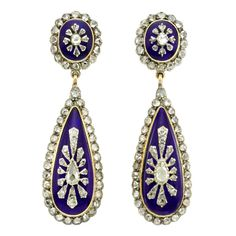 Antique Blue Glass Diamond Drop Earrings. A pair of antique blue glass and diamond drop earrings, each oval cluster top with a tear shaped drop mounted in silver and gold, c 1860-1869