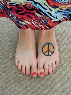 Peace sign foot tattoo