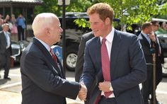 Prince Harry was photographed outside the U.S. Senate on May 9, 2013 with Senator John McCain as he attended the launch of a fundraising drive for the HALO trust landmine clearance charity. His late mother, Diana, Princess of Wales was a patron of the HALO trust and he has said it is important to carry on his mother's work.