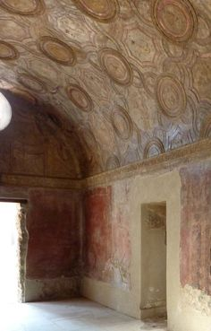 Interior view of the entrance to the men's apodyterium (changing room) at the Stabian baths in Pompeii.