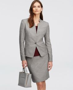 Working woman wearing grey skirt suit for business formal attire