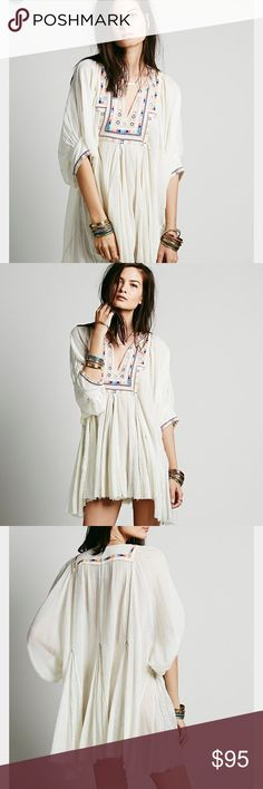 Free People One Near Perfect Tunic Oversized sheer gauzy tunic with traditional embroidery design throughout. Hidden ties on the inside of the garment adjust to create an oversized silhouette or cinch to create a narrowed waist. Hi-Lo hem.  *FP One is an exclusive collection made with love from India. Defined by bold embellishments and natural-feeling fabrics, the collection brings a modern twist to old world techniques.  *100% Cotton *Hand Wash Cold Free People Dresses