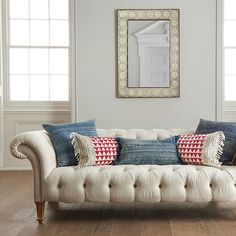love this cushion combination, the denim blue has a real Americana feel to it and would break up the block of tan leather on the sofas