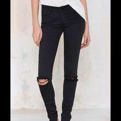 Black Distressed Skinny Jeans NEW! Brand New without tags, stylish black distressed skinny jeans. Fits a size 2 and 4 Distressed only in the knee and at the very bottom. Will look amazing if you Dress them up with heels or wear it grunge with a leather jacket and boots. PRICE FIRM Pants Skinny