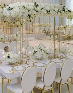 Tall White Wedding Floral centerpieces White Wedding Reception Chairs White and Gold Wedding Source by PinkPoppyWeddings The post Tall White Wedding Floral centerpieces White Wedding Reception Chairs White an& appeared first on Trendy. White Wedding Decorations, Luxury Wedding Decor, Wedding Table Centerpieces, Floral Centerpieces, Reception Decorations, Event Decor, Ivory Wedding Decor, Centrepiece Ideas, Reception Ideas