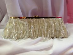Dangle Beaded Clutch in Cream: $34.99. Styles and colors not guaranteed. This item is currently at our Granite Bay Location. Call or Email for more information. Email: polkadotsproshop@gmail.com Phone: 916-791-9070
