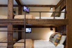 simple bunkbeds with metal pipe stair and railing