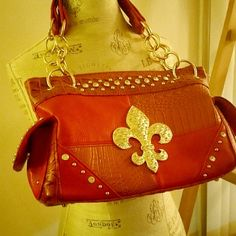 Red Rustic Fleur-De-lis Bag Brand new!! If bling and pockets are your thing, this is YOUR bag! Many pockets inside and out. Animal print on the inside and inside flaps on th ed outside. Sold a bunch of these in my boutique and this is the only one left! Bags Shoulder Bags