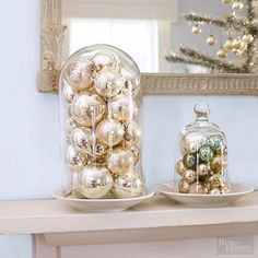Here's a pretty Christmas mantel hack that involves minimal effort: Simply organize your orbs in a glass cloche. When you're happy, turn it over and place on a plate for the ultimate mobility. All your guests will love your Christmas decorations.