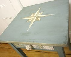 Without a doubt the beautifully painted compass is a focal point of this side table. But Nancy of Sea Rose Cottage didn't stop there. She completed the nautical theme with a navigation chart that is decoupaged to the front drawer, and a cute Monkey Fist pull.