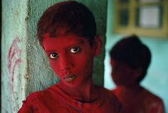 Steve McCurry, Red Boy, Bombay, India, 1996, C-type print on Fuji Crystal Archive paper