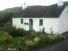 Traditional Irish cottage near the Mountains of Mourne.