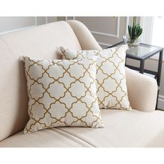 These Abbyson Living pillows add a stylish and modern touch to any room in your home. Featuring a gold lattice pattern, this chic pillow adds instant style to any room in your home.