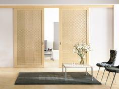 CLOSET DOORS? Modern interior sliding door featuring a maple wood latticed sliding panel
