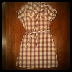 Plaid shirtdress White background with paid in hues of pink, black and gray. Short sleeve with hot pink button and tabs. Collared, two breast pockets, button up, hot pink buttons. Fabric sash to belt at waist. Tag has removed. Dresses