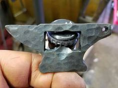 Anvil bottle opener