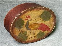 "A Harvard Style Oval Pantry Box…Square Nailed…Old Original Red Wash with a Full Distlefink Decoration Painted on the Lid…The Distlefink is actually a stylized Goldfinch and in Pennsylvania Dutch is a sign of ""Good Luck""…The Colors are vivid but Mellow…"