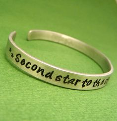 Peter Pan Inspired - Second Star To The Right And Straight On 'Til Morning - A Hand Stamped Aluminum Bracelet. $14.95, via Etsy.