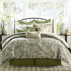 Lovely bedroom in earth tones from light tan to sage and moss green.....