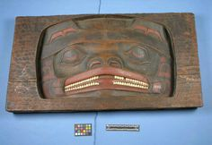 Tlingit bear house plank with opercula. 19th century.