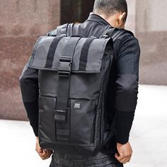 "Mission Workshop Rambler is a 22 L / 44 L messenger backpack. The Rambler features a water-resistant main compartment which can be used in either ""roll-top"" mode, or in the traditional ""flap-down"" configuration. A key feature of Black Backpack, Backpack Bags, Leather Backpack, Mission Workshop, Cuir Vintage, Top Backpacks, Messenger Bag Men, Cloth Bags, Laptop Bag"