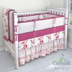 Crib bedding in Pink Cherry Blossom, Coral Hearts, Coral Flying Arrow, Fuchsia Drops, Solid Fuchsia, Pink Hearts, Bright Pink Pindot. Created using the Nursery Designer® by Carousel Designs where you mix and match from hundreds of fabrics to create your own unique baby bedding. #carouseldesigns
