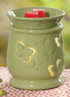 Visit my website @ www.holliewoodscents.scentsy.us    FEBRUARY SCENTSY WARMER | Flutterby Scentsy Warmer | Conjure the magic of the first green signs of spring with Flutterby. Fanciful butterfly cutouts cast delightful shadows on the wall when lit.