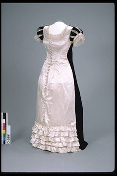 White satin dress made of black and midnight blue cut velvet; machine-made silk lace edging.  Canadian, 1880-1889  Artifact Number D-9891.1  Canadian Museum of Civilization