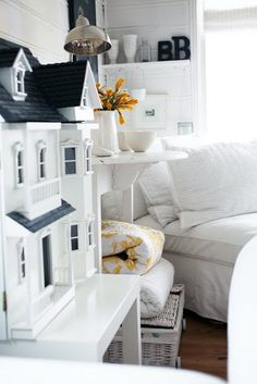 Ok...it's not a real house but a Dollhouse...but it's as cute as can be...what little girl wouldn't want a gorgeous dollhouse like this?