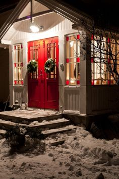 Tiny house in Norway...love the windows with the red squares and that red door