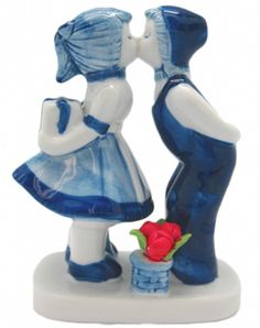 Ceramic delft blue kissing couple with tulips that will add a Dutch theme to your home! - Features Colored Tulips - Hand painted - See our collection for more unique Delft Blue Porcelain items! - Appr