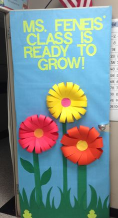 Classroom door decoration! I like how they made the flowers.