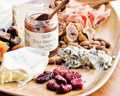 A delicious cheese plate with figs and jam