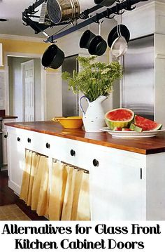 Many people prefer a few of their kitchen cabinet doors to have glass fronts to break up the monotony of all wood front cabinet doors.  Glass front cabinet doors are beautiful, however you have to be careful that the items inside are always arranged for constant display and they must be constantly cleaned of fingerprints.  Here are a few different alternatives for glass front kitchen cabinet doors that are not so revealing.