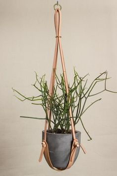 Long Leather Plant Hanger // LOVE this plant holder. Could be made from leather scraps