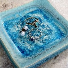 This picture does not do justice to this incredible pottery. The glass adds such life and light. Must see to believe. I bought one for each woman in my family to hold rings on kitchen counter. Paloma Pottery - Jewelry Dish Square, $18.50 (http://www.palomapottery.com/jewelry-dish-square/)
