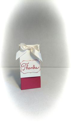 """A gift box/bag made from quality card stock. The word thank you on as a sentiment. Can also be happy birthday, for you or just because   It measures 5"""" tall 2.5"""" wide and 1.5"""" depth    It holds two nail Polish easily. Can also hold chocolates or sweets as a gift.   I have shown nail Polish in the picture, these are NOT INCLUDED with the gift bag 