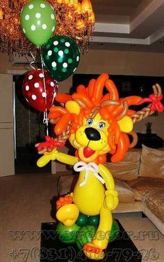 Cute Balloon Lion holding a bouquet of polka-dot balloons.