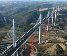 Millau Viaduct - Millau, France The Millau Viaduct is the tallest bridge in the world with one mast reaching 1125 feet above the base (even larger than the Eiffel Tower). Places Around The World, Around The Worlds, Paris Airport, High Bridge, Sky Bridge, Over The River, Above The Clouds, World Records, Trendy Tree