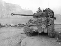 "British Sherman ""Firefly"" tank in Namur on the Meuse River December 1944."