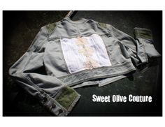https://www.etsy.com/listing/202054646/womens-m-one-of-a-kind-restyled-jacket?ref=related-5   Womens, size M, high waisted, one of a kind, restyled jacket. The original jacket has a military feel with a standing collar. Both the front and the back of this jacket are embellished with a textured cotton material and an overlay of lace flower appliques. The inside of the jacket is lined with a shiny gold lame' fabric.