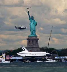 """Definitely """"Cosmos"""" related althought not as colorful as other pins.  Space shuttle Enterprise passes the Statue of Liberty."""
