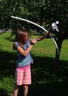 PVC bow and dowel arrows.  Also has link to cute 'quiver' (arrow holder).  Super easy and fun!